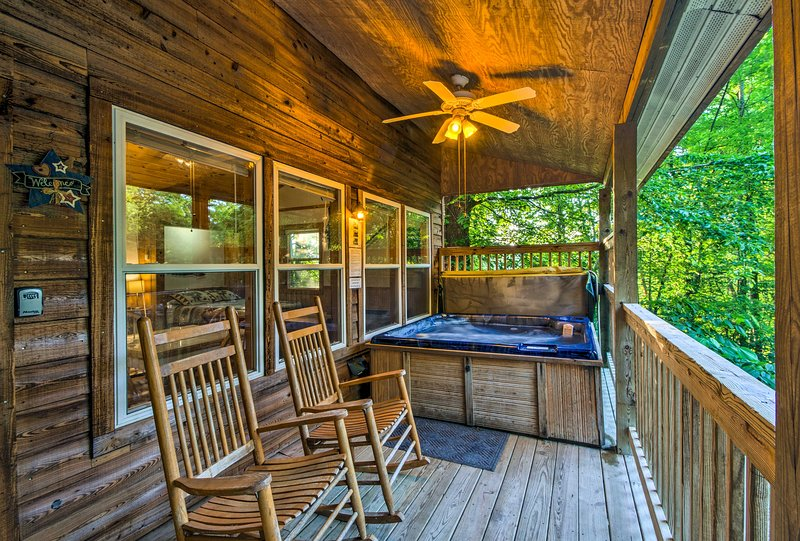 Relax on the picturesque front porch of this vacation rental home for 4.