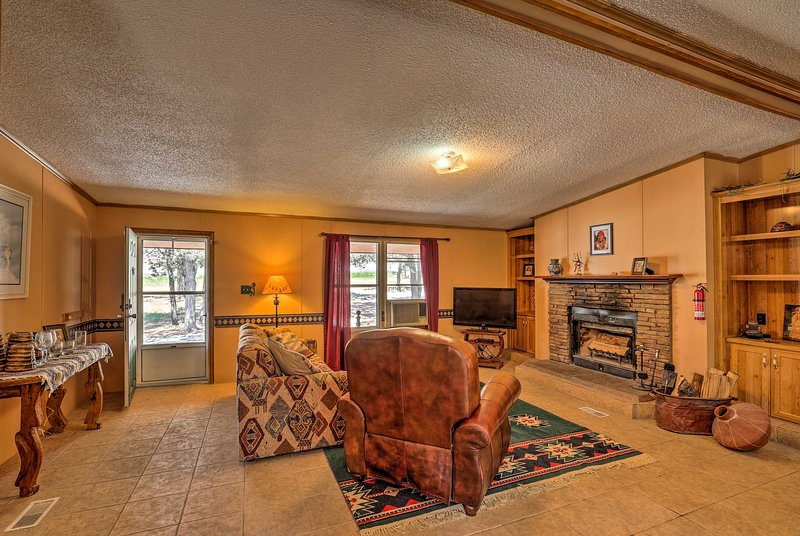 Experience mountain living at this 3-bedroom, 2-bath vacation rental cabin.