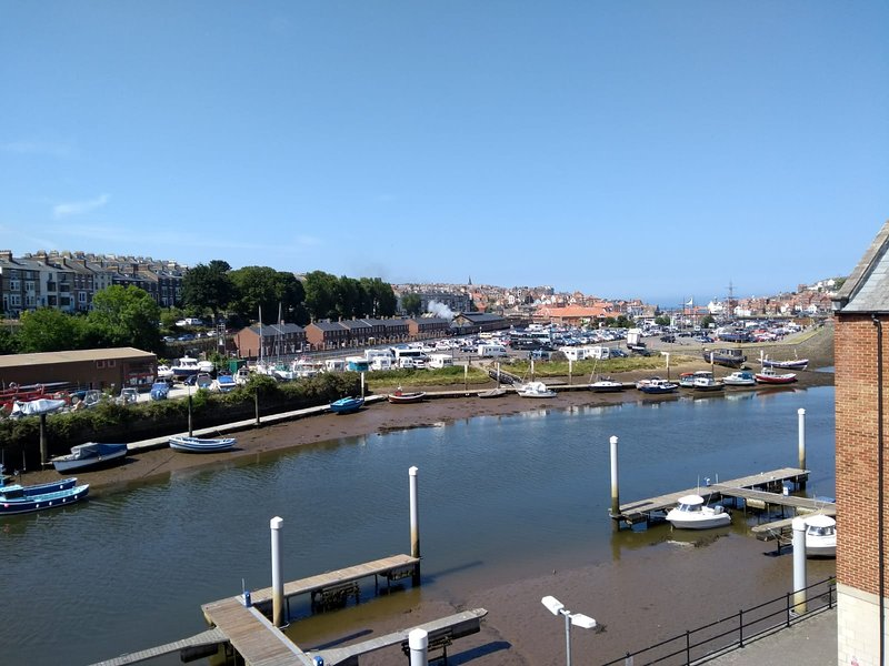 View from the apartment looking out over the upper harbour, the steam trains, town and out to sea.