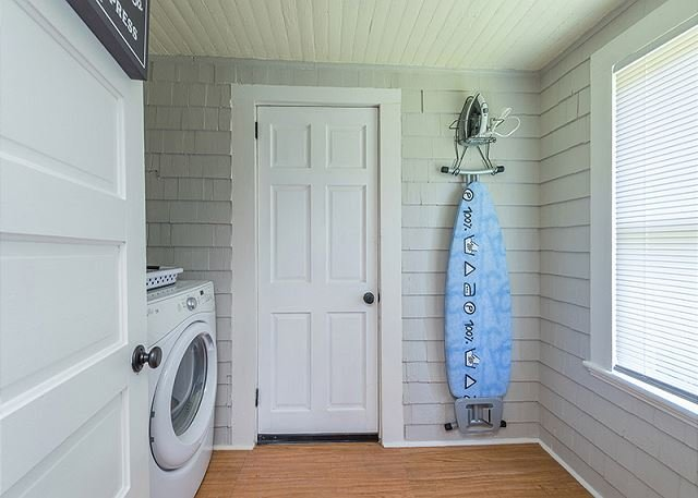 Laundry room with washer and dryer, accessible from back bedroom
