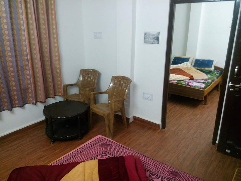 Family suite room which is double room set with double bed in Each room and 1 attached Bathroom