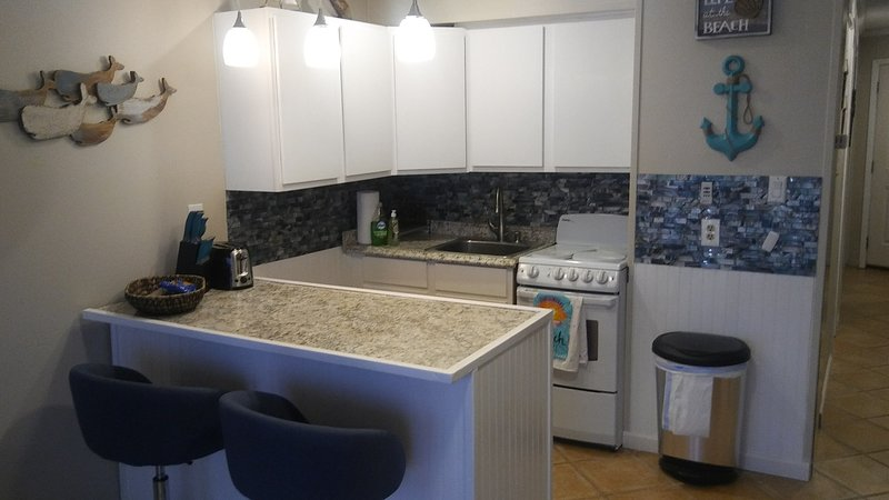beautiful kitchenette complete with all appliances and kitchen tools