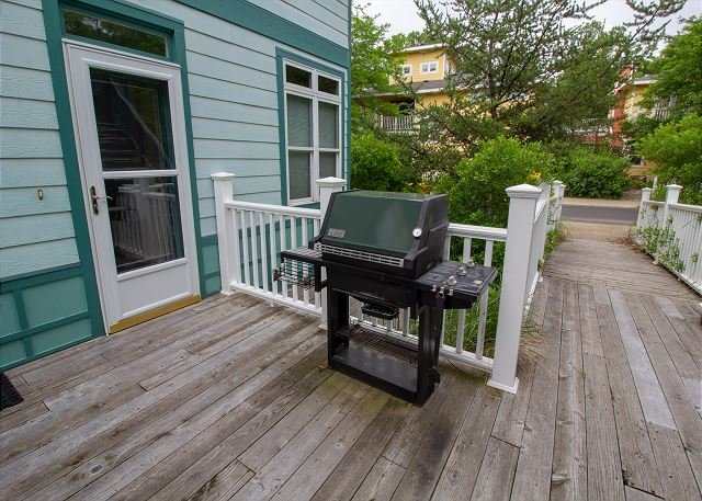 Gas grill on back porch
