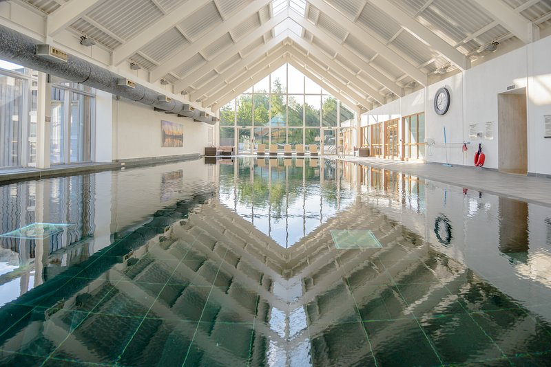 The beautiful Welsh slate lined HEATED indoor swimming pool at the Luxury Spa complex