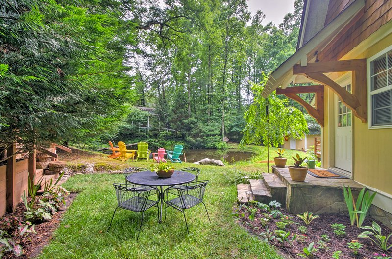 The yard is furnished with a shared 4-person table, pond and fire pit.
