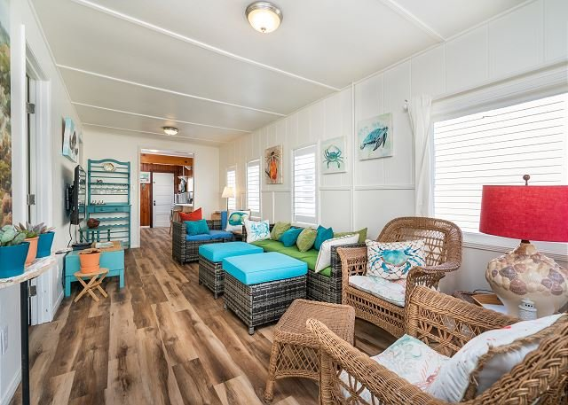 This beach home has been recently remodeled with new hardwood fl