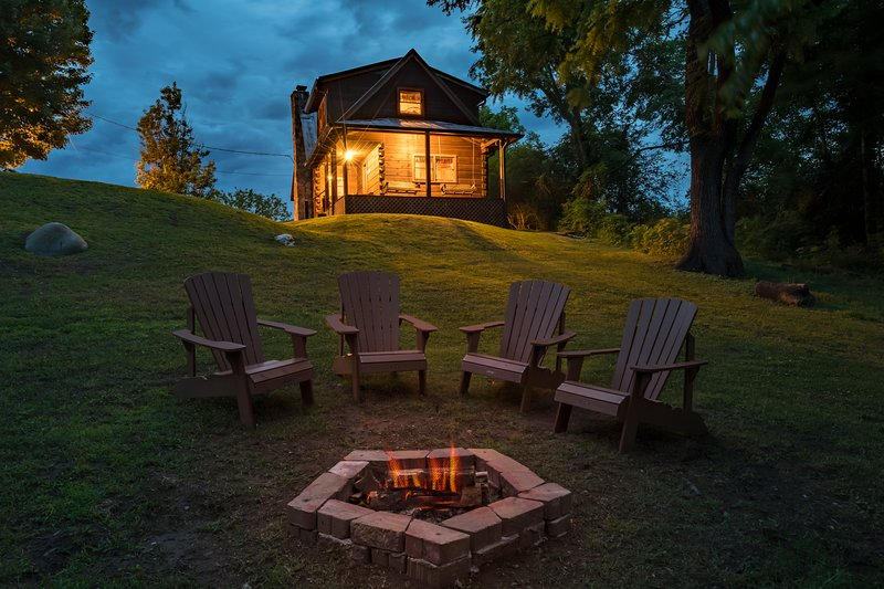 River-side Seating and Outdoor Fire Pit at Night
