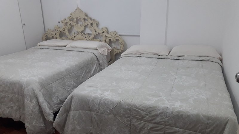 Second room with two double beds or two beds.
