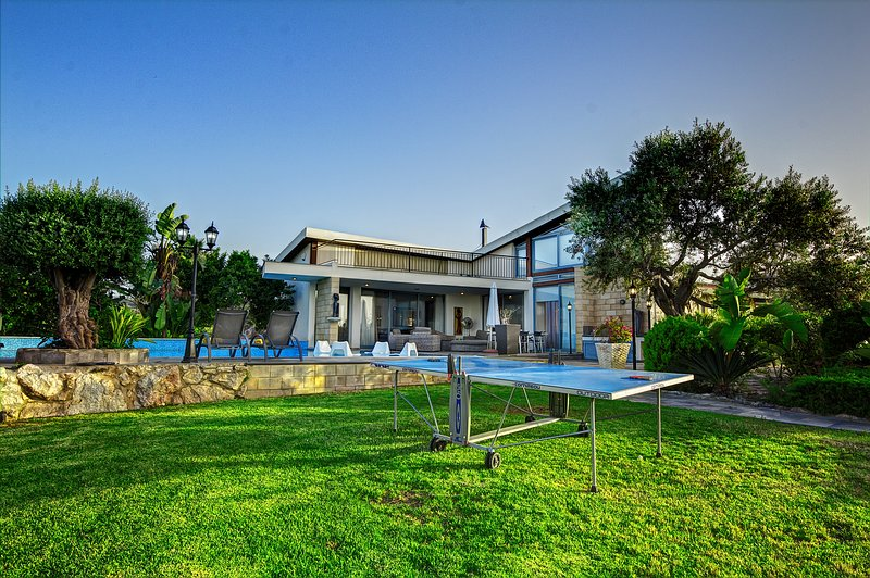Garden, pool area and bungalo