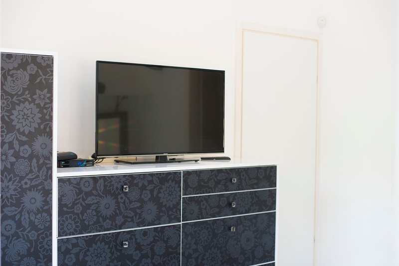 Wardrobe and cable TV in bedroom