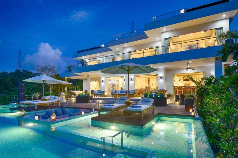 Pool and villa at night