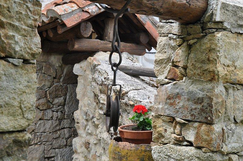 Pozo restaurado de piedra