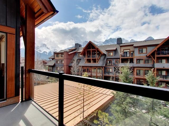 Step out onto your huge wrap around deck and experience the Rockies at your doorstep
