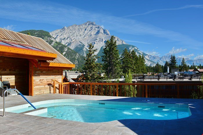 Enjoy the on-of-a-kind roof top hot pools with mountain views!
