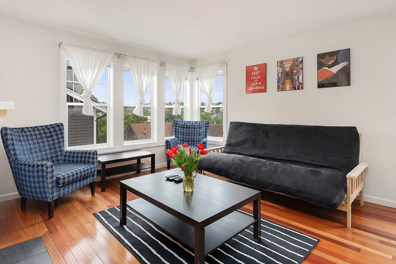 The comfortable living room has a futon for extra sleeping space