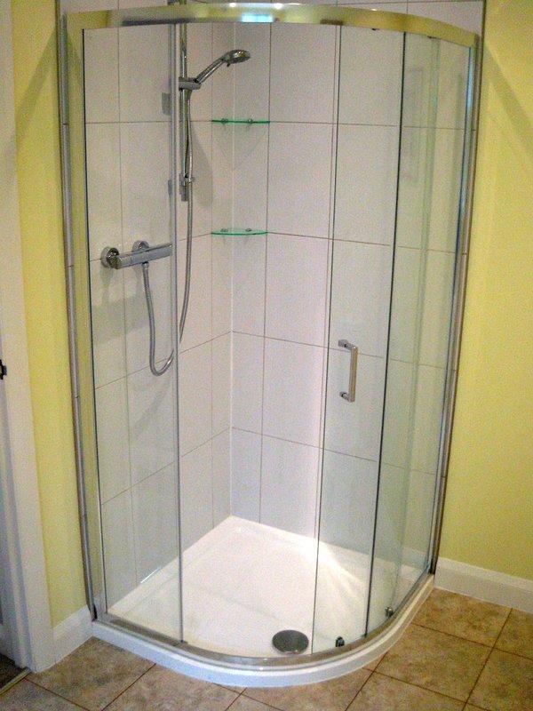Large shower cubicle, adjacent WC