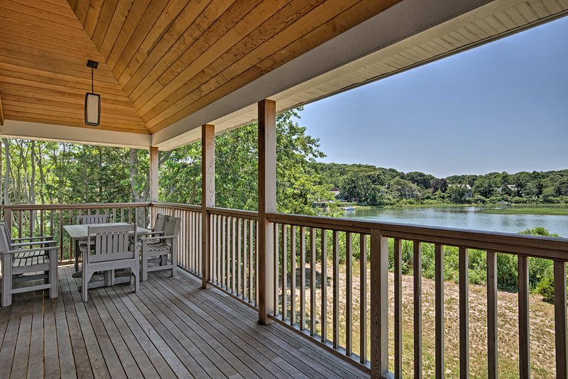 Hang on the vacation rental home's spacious deck overlooking the water.