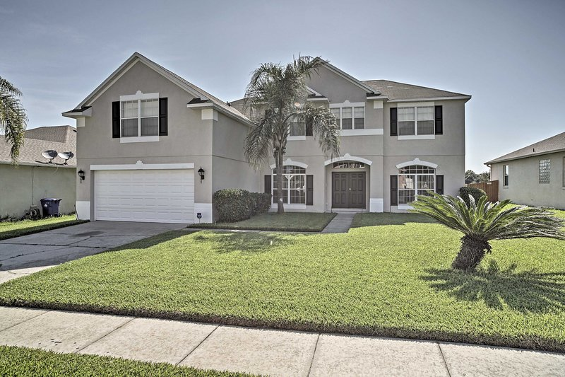The  5BR, 3-bath Ocoee home boasts a private outdoor pool and enclosed lanai.