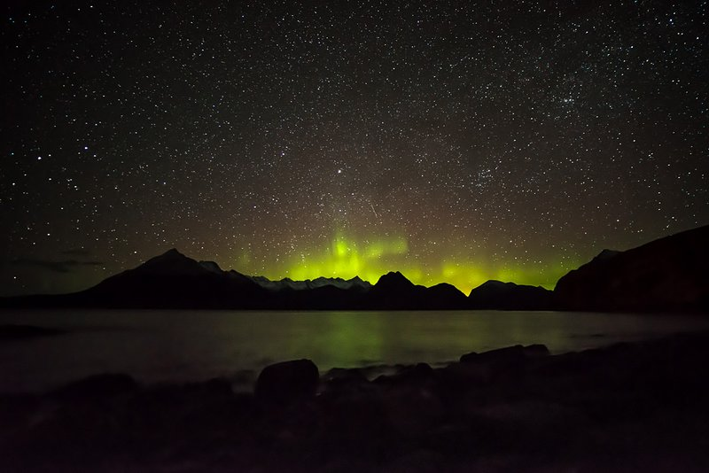 The Northern Lights (Aurora Borealis) and Milky Way galaxy above Skye's Cullin mountains.