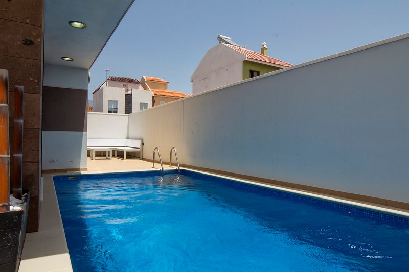 Private pool with terrace furniture and barbecue