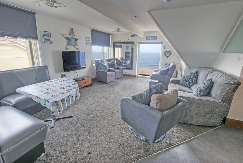 Blue Seas, open plan lounge/dining.kitchen areas with stunning sea views