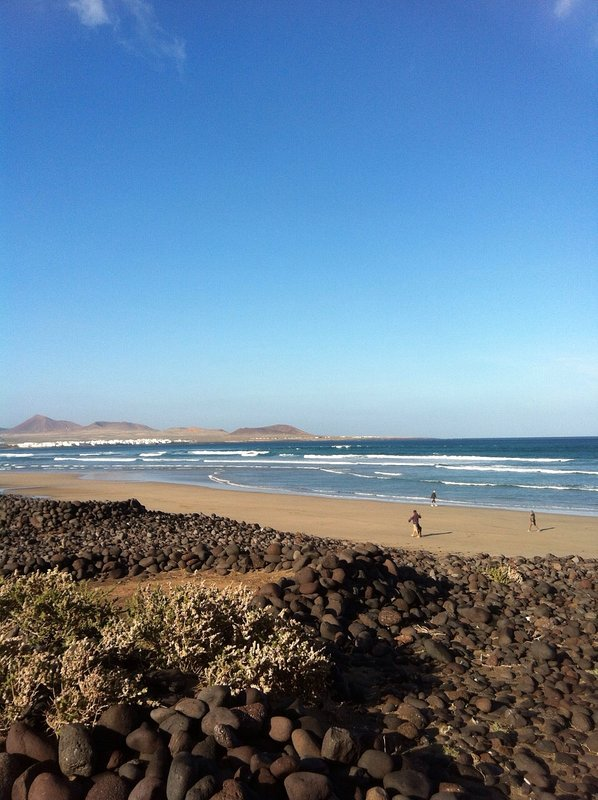 Famara beach. Perfect for practicing your surfing and kite-surfing. Around 20 minutes driving