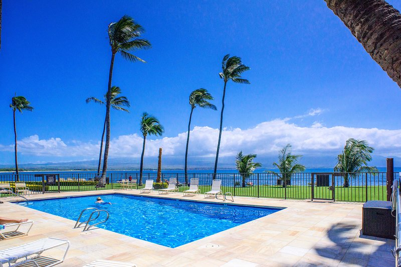 The community pool is just steps away from the ocean.