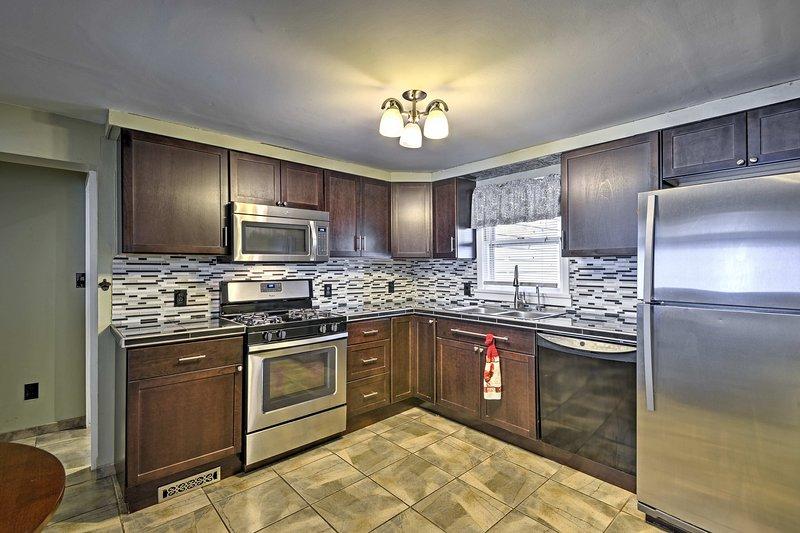 Étape dans le coin dans la cuisine entièrement équipée.