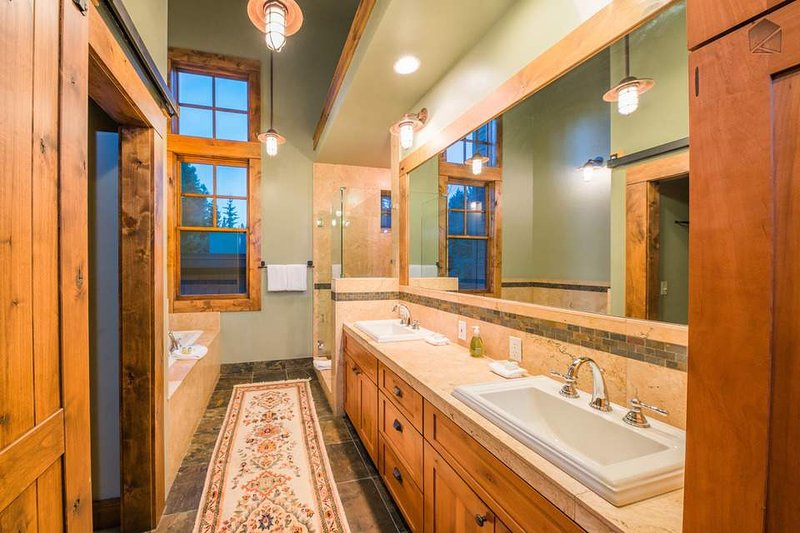 The elegant Master Bathroom features a stand-alone tub and shower.