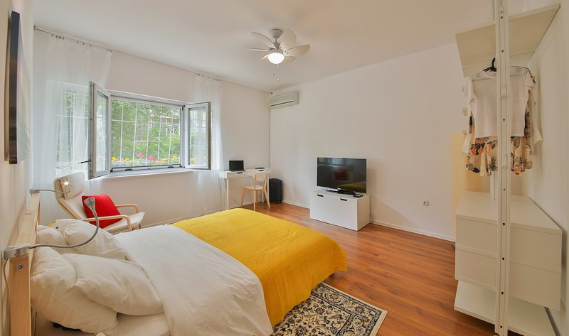 spacious bedroom with 43' smart TV and 300 cable channels