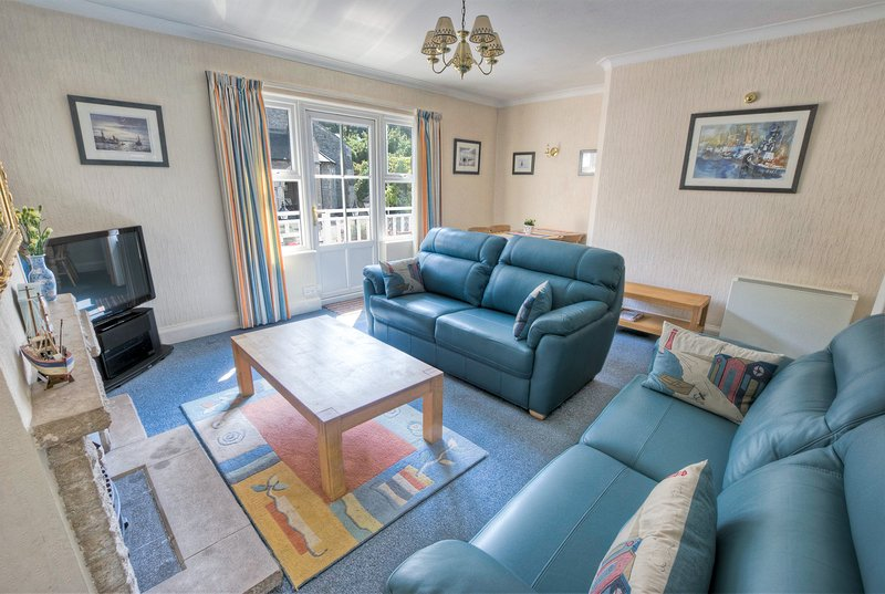 Lounge with balcony overlooking the Fore Street, leading down to the sea