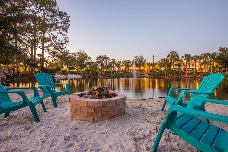 A fire pit next to the lake