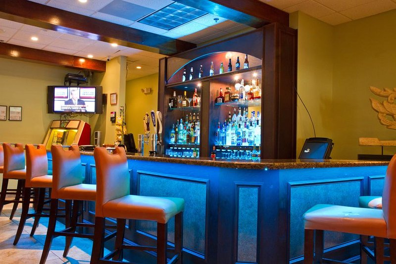 Bar within a building, with many exotic drinks specials