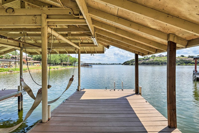 The dock is the launching point for swimming and boating adventures.