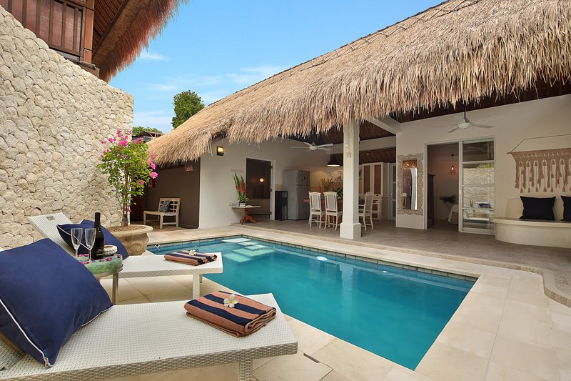 Bali Luxury 2 Bedroom Villas Exterior of villa with sunbeds and outdoor breakfast area