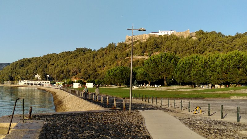 Promenade towards Praia da Saúde. Forte de Sao Filipe on top of the hill