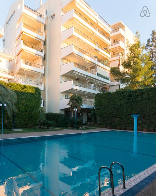 The apartment building with swimming pool in the foreground