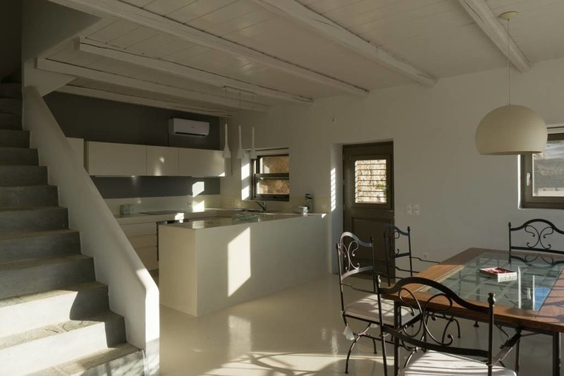 Dining and kitchen areas, with stairs leading to the master bedrom
