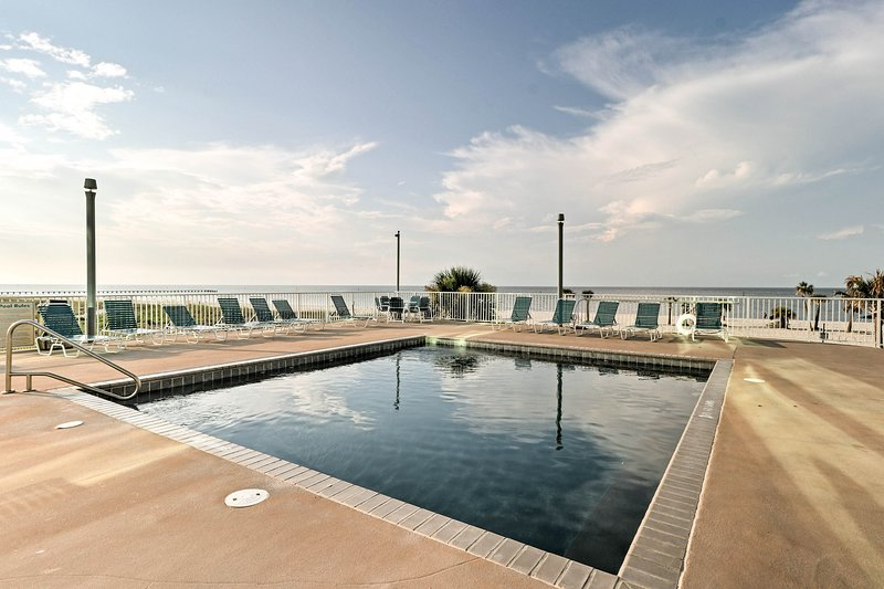 Just outside of the vacation rental's door is the community pool!