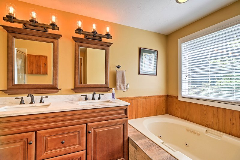 Soak your cares away in the master bathroom.