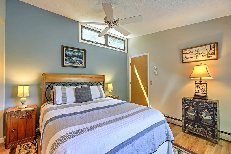 Rest and recuperate in the beautiful master bedroom with a queen-sized bed.