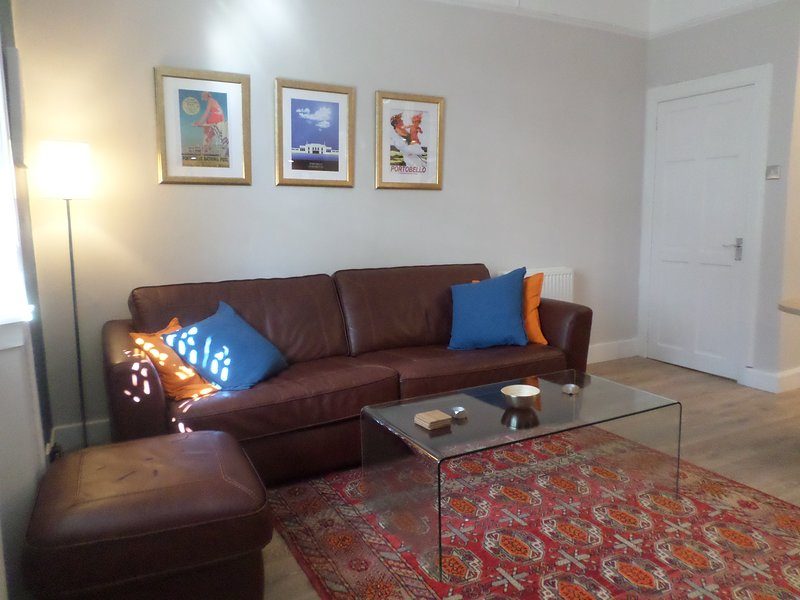 Lounge, 4 seater settee with footstool and glass coffee table