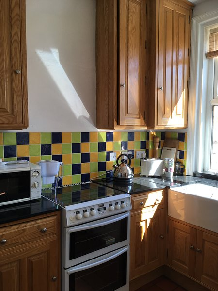 This is one half of the kitchen dining area which has gas cooking facilities and woodburner.