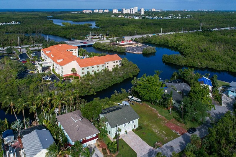 Tropical family home located on Cocohatchee River. Convenient gulf access.
