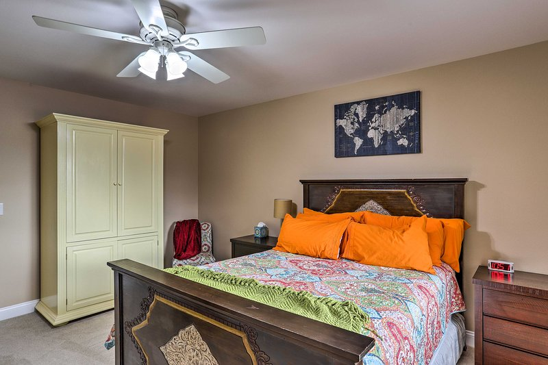 The second bedroom also offers a comfortable queen bed.