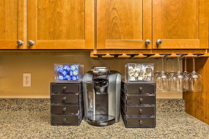 Prepare a fresh cup of hot coffee from the Keurig.