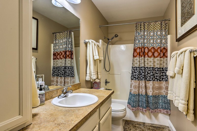 Draw a bubble bath in the shower/tub combo in the second bathroom.