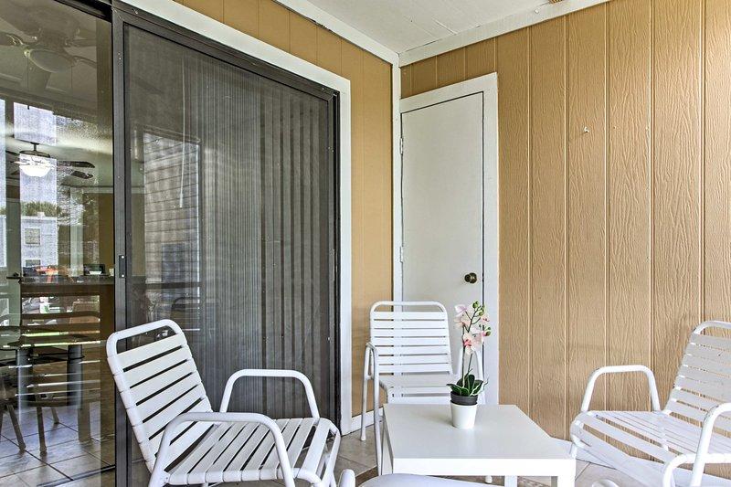 The 2BR, 2-bath condo features a sunroom and familiar home conveniences.