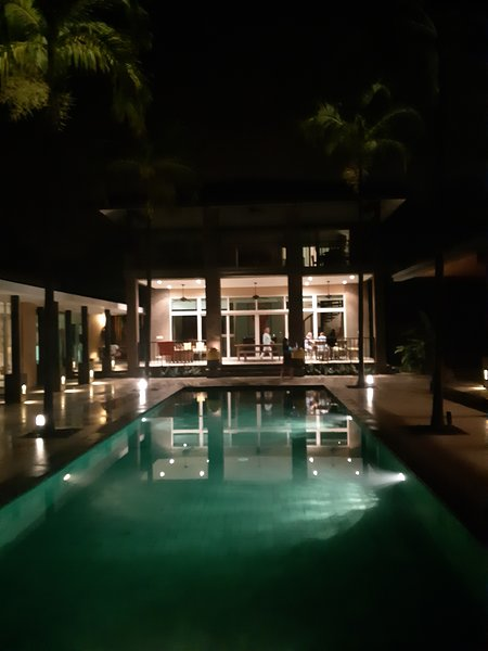 Night view of house & pool
