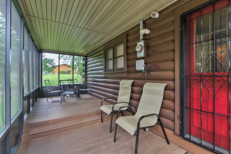 Enjoy the perks of a private screened in deck overlooking the lovely backyard.